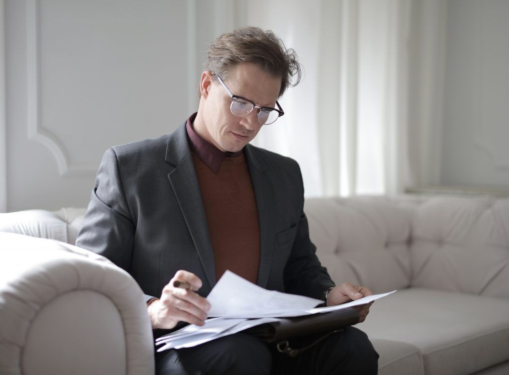 lawyer looking through some papers