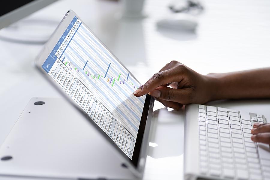 Worker using timesheet application